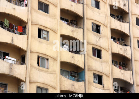 Messy balconies on an apartment building in Jeddah - Stock Photo
