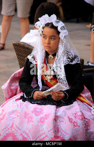 Traditionally dressed up girl at the Hogueras de San Juan Festival in Alicante, Spain - Stock Photo