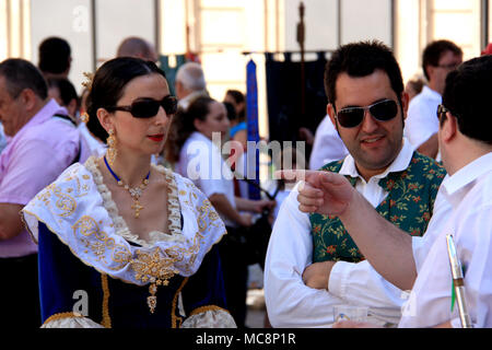 Traditionally dressed up people at the Hogueras de San Juan Festival in Alicante, Spain - Stock Photo