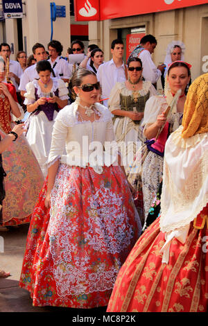 Traditionally dressed up women at the Hogueras de San Juan Festival in Alicante, Spain - Stock Photo