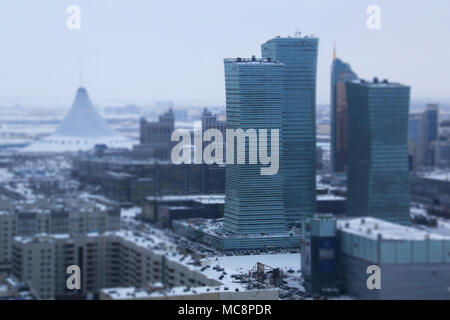 The Capital's skyline and the Khan Shatyr Entertainment Center in the background: Nur-Sultan, Kazakhstan, at -24 degrees Celsius - Stock Photo