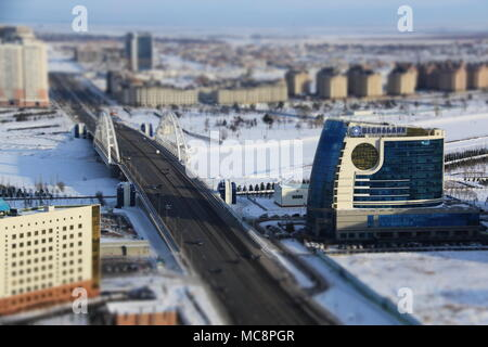 Tsesnabank building next to frozen Ishim River at -24 degrees Celsius in Nur-Sultan, Kazakhstan - Stock Photo