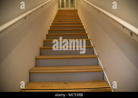 Interior house narrow wooden stairs no people - Stock Photo