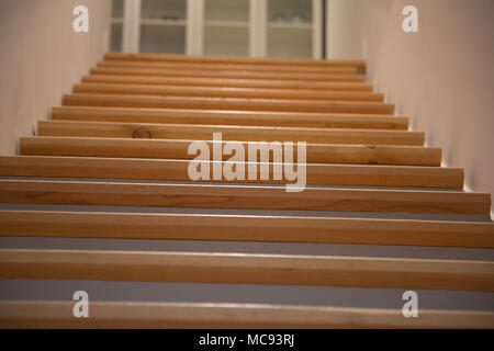 Closeup wooden stairs indoor background - Stock Photo