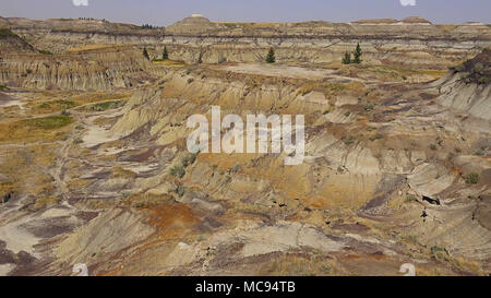 Drumheller Hoodoos at Sunrise in Alberta, Canada. - Stock Photo
