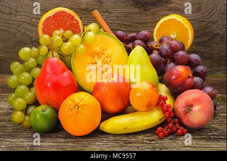 arrangement of fresh fruits from market over wooden planks - Stock Photo