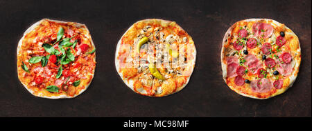 Pizza pattern. Three pieces set on dark background. Top view, copyspace - Stock Photo