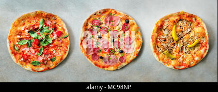 Pizza pattern. Three pieces set on grey concrete background. Top view, copyspace - Stock Photo