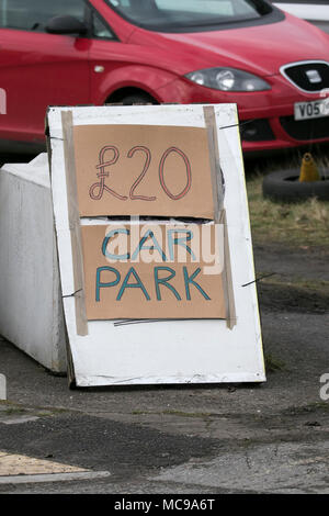 Private Parking for the Aintree Grand National in Aintree, using temporary cardboard car park parking signs in Liverpool, Merseyside, UK - Stock Photo