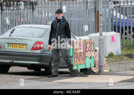 Private Parking for the Aintree Grand National in Aintree, using temporary cardboard car park parking signs in Liverpool, Merseyside, UKgns - Stock Photo