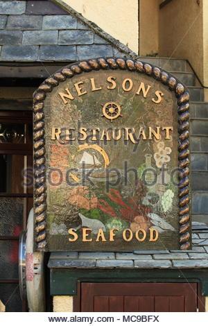 Nelson's Seafood Restaurant Sign Polperro Cornwall England June 2015 - Stock Photo