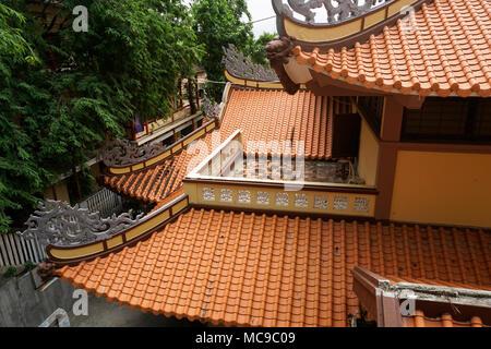 Clay tile roofs of Chua Long Son Pagoda, Nha Trang, Vietnam - Stock Photo