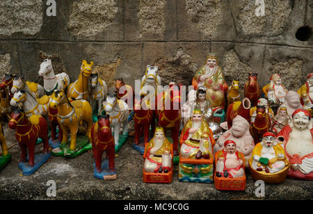 Buddhist offerings at Chua Long Son Pagoda, Nha Trang, Vietnam - Stock Photo