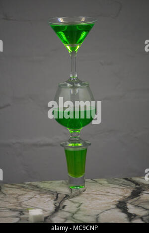Absinthe shots near sugar cubes on white background top view copy space - Stock Photo