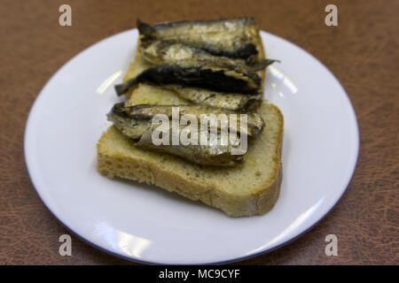 Sandwich with sprats, and caviar, onion, on a wooden background. Top view. Copy space - Stock Photo
