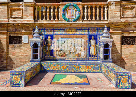 Ceramic bench on the Plaza de Espana in Sevilla, with a historic episode of Avila. Was built in 1929 for Ibero-American exhibition. Andalusia, Spain. - Stock Photo