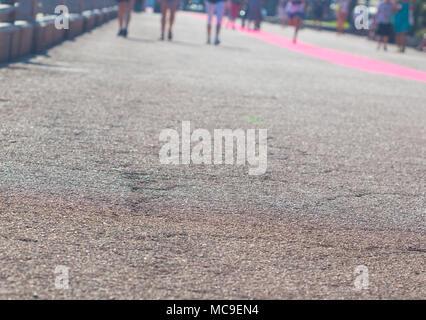 People walking in the street, blurry, legs of people walking at summer. - Stock Photo