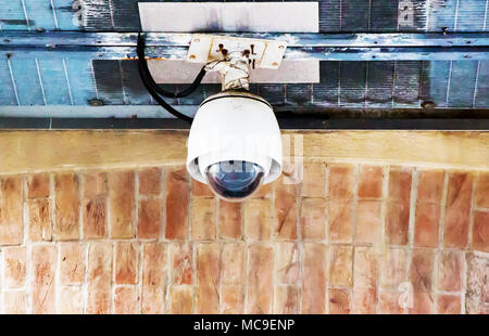 Security CCTV Camera on the old wall. - Stock Photo