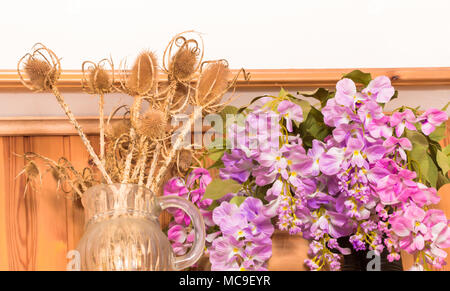 Bouquet of dried flowers in vase on wood background,Flower in vase, Beautiful colorful plastic flower bouquet in vase. - Stock Photo