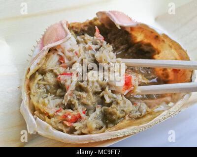Fresh grilled Kanimiso crab meat Japanese style - Stock Photo