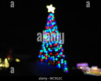 Defocused abstract light Christmas tree shape to celebrate Xmas and New Year Festival - Stock Photo