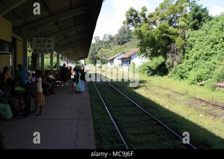 People waiting for the arriving train at the Ella railway station, Ella, Sri Lanka - Stock Photo