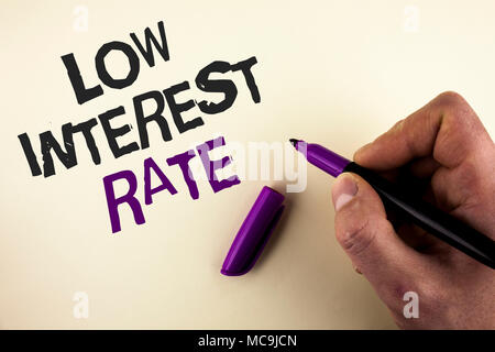 Conceptual hand writing showing Low Interest Rate. Business photo showcasing Manage money wisely pay lesser rates save higher written by Man plain bac - Stock Photo