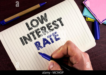Conceptual hand writing showing Low Interest Rate. Business photo showcasing Manage money wisely pay lesser rates save higher written by Man Notebook  - Stock Photo