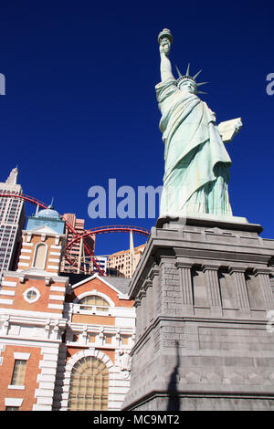 View of the Statue of Liberty replica in front of the artificial NYC skyline and the rollercoaster of the New York-New York, Las Vegas, NV, USA - Stock Photo