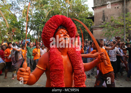 Dhaka, Bangladesh. Hindu devotees take part in lal Kach festival during the last day of Bengali month in Munshigonj, near Dhaka, Bangladesh on April 13, 2018. The festival is well known for the local community for more than hundred years. The Hindu youth and men paint themselves with red color and attend a procession holding swords as they show power against evil and welcome the Bengali New Year 1425 on 14 April 2018. © Rehman Asad/Alamy Stock Photo - Stock Photo