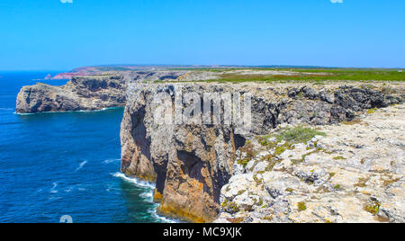 View of famous Cliffs of Moher and wild Atlantic Ocean, Portuguese coastline close to Cape St. Vincent in Portugal on a sunny and clear day with the b - Stock Photo