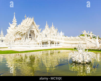 Wat Rong Khun Or known as the White Temple In Chiang Rai, Famous in Thailand. - Stock Photo