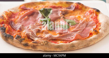 Hot true ITALIAN PIZZA pepperoni pizza on board on white wooden table with decoration. Copy space for your logo. Ideal for commercial. - Stock Photo