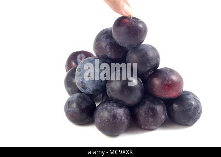 Sweet plum, prunes isolated on white background, Group of plums, prunes with leaf isolated on a white background. Fresh of plum, prunes fruit that hel - Stock Photo