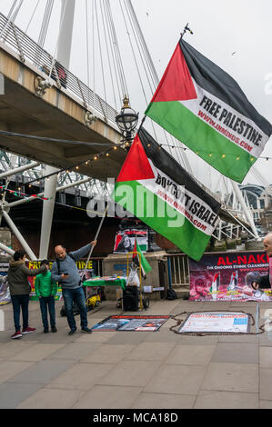 April 13, 2018 - London, UK. 13th September 2018. A vigil on the South Bank of the River Thames on Palestinian Prisoners Day highlights the plight of the roughly 6,500 Palestinians currently in Israeli jails, around 350 of them children. The protesters included several Palestinians and were joined by an anti-zionist ultra-orthodox Jew. Their display included an actual size drawing of an Israeli underground prison cell in which children are held in isolation. The protesters handed out leaflets and talked with those walking by, and speeches gave facts about the prisoners. In two months this yea - Stock Photo