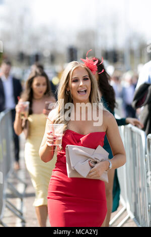 Aintree, Liverpool, Merseyside. 14th April 2018.  The most famous event in the horse racing calendar welcomes people on this very special parade of Ladies outfits & the finest female fashions.  Racegoers have been urged to 'smarten up' to make the event more 'aspirational' as thousands of glamorous women pour through the entry gates on the one and only 'Grand National' as up to 90,000 visitors are expected to attend the spectacular National Hunt Racing event.   Credit: Cernan Elias/Alamy Live News - Stock Photo