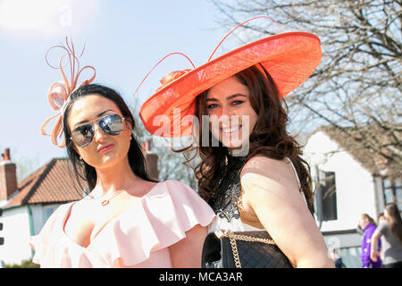 Aintree, Liverpool, Merseyside. 14th April 2018.  The most famous event in the horse racing calendar welcomes people on this very special parade of Ladies outfits & the finest female fashions.  Racegoers have been urged to 'smarten up' to make the event more 'aspirational' as thousands of glamorous women pour through the entry gates on the one and only 'Grand National' as up to 90,000 visitors are expected to attend the spectacular National Hunt Racing event.   Credit: Mediaworld Images/Alamy Live News - Stock Photo