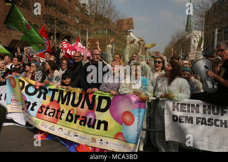 Germany, Dortmund, 14 April 2018.Counter-protestors carry a banner reading 'Dortmund - Bunt statt braun' (lit. Dortmund - colourful instead of brown) during a demonstration of right-wing extremists in the city centre. The police expects 400 to 600 right-wing extremists and several thousand counter-protestors. Photo: David Young/dpa - Stock Photo