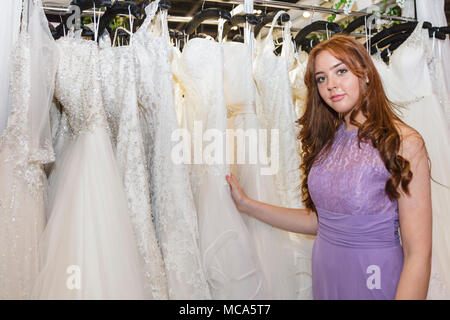 ExCel London, London, 14th April 2018. An assistant from 'Bell Amore' shows the collection. The National Wedding Show takes place at ExCel London Exhibition Centre this weekend, showcasing the latest bridal trends, accessories, dresses and everything around planning the perfect wedding. Credit: Imageplotter News and Sports/Alamy Live News - Stock Photo
