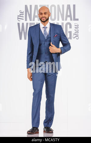 ExCel London, London, 14th April 2018.  Menswear wedding fashion is modelled on the catwalk. The National Wedding Show takes place at ExCel London Exhibition Centre this weekend, showcasing the latest bridal trends, accessories, dresses and everything around planning the perfect wedding. Credit: Imageplotter News and Sports/Alamy Live News - Stock Photo