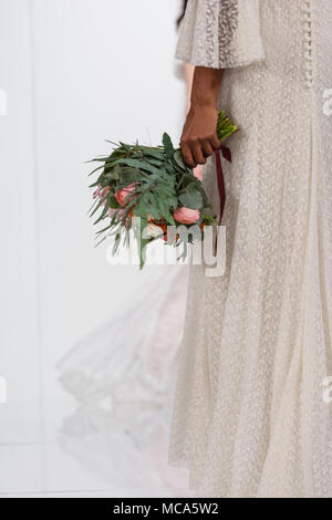 ExCel London, London, 14th April 2018. A flower bouquet is shown on the catwalk. The National Wedding Show takes place at ExCel London Exhibition Centre this weekend, showcasing the latest bridal trends, accessories, dresses and everything around planning the perfect wedding. Credit: Imageplotter News and Sports/Alamy Live News - Stock Photo