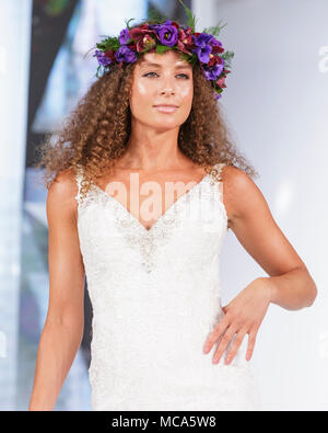 ExCel London, London, 14th April 2018. Beautiful hats and head dressings shown by models on the catwalk. The National Wedding Show takes place at ExCel London Exhibition Centre this weekend, showcasing the latest bridal trends, accessories, dresses and everything around planning the perfect wedding. Credit: Imageplotter News and Sports/Alamy Live News - Stock Photo