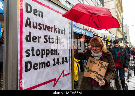 Berlin, Germany, 14 April 2018. A woman passes by poster during the demonstration under the motto 'resist rental madness'. More than 13,000 people demonstrated against 'repression and rent madness' in the capital. Credit: SOPA Images Limited/Alamy Live News - Stock Photo