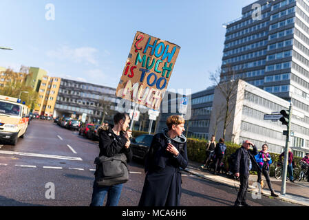 Berlin, Germany. 14th Apr, 2018. ''How much is too much'' is written on a sign during the demonstration under the motto ''resist rental madness''. More than 13,000 people demonstrated against ''repression and rent madness'' in the capital. Credit: Markus Heine/SOPA Images/ZUMA Wire/Alamy Live News Credit: ZUMA Press, Inc./Alamy Live News - Stock Photo