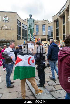 Glasgow, Scotland.14th April 2018. A man wears the Sahrawi Arab Democratic Republic flag at the Defend Catalan Democracy. Stop The Repression demonstration at Buchanan street steps, Glasgow, Scotland. Credit: Kelly Neilson/Alamy Live News. - Stock Photo