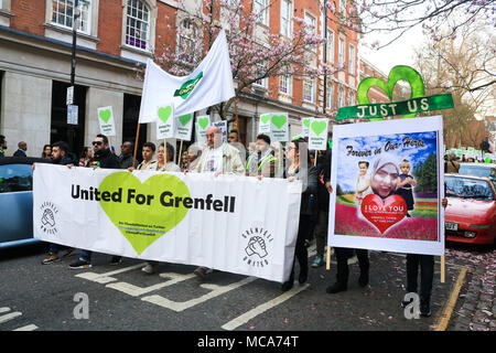 London UK. 14th April 2018. Relatives of bereaved, and Grenfell survivors  marched from Kensington and Chelsea Town Hall on the 10th month anniversary of the Grenfell fire disaster to demand justice and rehousing for the families  that were affected by the fire tragedy on 14th June 2017 Credit: amer ghazzal/Alamy Live News - Stock Photo