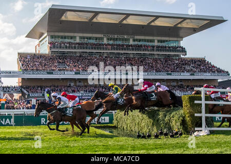 Randox Health Grand National, Aintree, Liverpool, Merseyside. 14th April 2018. Grand National horses & riders race over the grandstand water jump.  Credit: Mediaworld Images/Alamy Live News - Stock Photo
