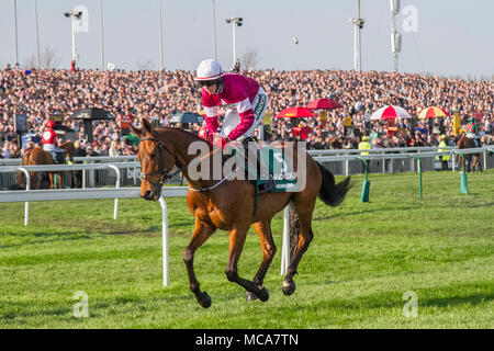 Aintree, Liverpool, Merseyside, UK, 14 April 2018. . Grand National horses gallop to the start line. Isolated large crowds at Liverpool, Merseyside, UK 7th April, 2016. Grandstand, racecourse, sport, horse, track, race, course, racetrack, stadium, entertainment, competition, derby, ride, success, view, city, outdoors, panorama, architecture, stand, speed, stakes, Heads of the crowd at Grand National Ladies first Day at Aintree. 5 VALSEUR LIDO ridden by Keith Donoghue.  Credit: MediaWorldImages/Alamy Live News - Stock Photo
