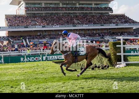 Aintree, Liverpool, Merseyside, UK, 14 April 2018. . Grand National horses gallop to the start line. Isolated large crowds at Liverpool, Merseyside, UK 7th April, 2016. Grandstand, racecourse, sport, horse, track, race, course, racetrack, stadium, entertainment, competition, derby, ride, success, view, city, outdoors, panorama, architecture, stand, speed, stakes, Heads of the crowd at Grand National Ladies first Day at Aintree. 38. FINAL NUDGE ridden by Gavin Sheehan. Credit: MediaWorldImages/Alamy Live News - Stock Photo