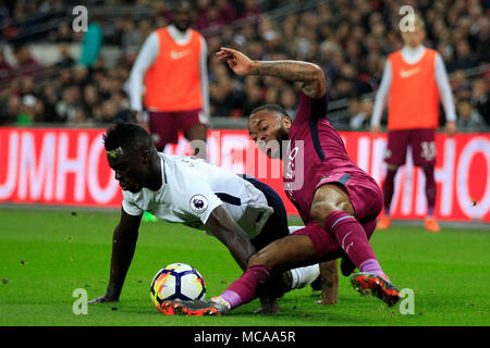 London, UK. 14th Apr, 2018. London, UK. 14th Apr, 2018. Raheem Sterling of Manchester City (R) battles for the ball with Davinson Sanchez of Tottenham Hotspur (L). Premier League match, Tottenham Hotspur v Manchester City at Wembley Stadium in London on Saturday 14th April 2018.  this image may only be used for Editorial purposes. Editorial use only, license required for commercial use. No use in betting, games or a single club/league/player publications. pic by Steffan Bowen/Andrew Orchard sports photography/Alamy Live news Credit: Andrew Orchard sports photography/Alamy Live News Credit: And - Stock Photo